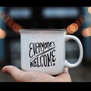 White ceramic Everyones Welcome speckled mug